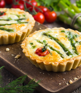 tart with asparagus and cherry tomatoes  on rustic background